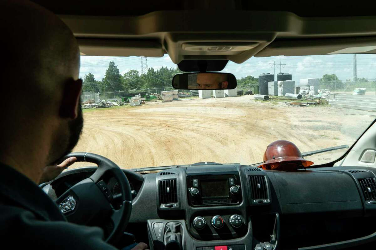 David Schatz, vice president of operations for Whinstone, drives around its facilities in Rockdale, Texas, on June 23, 2021.