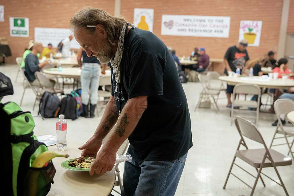 Rick Wallace, 59, sets his lunch down on a table at Corazon Ministries new Day Center located at Grace Lutheran Church. The day center acts as a hub, bringing local agencies under one roof for unhoused people to access while they escape the heat and get lunch.