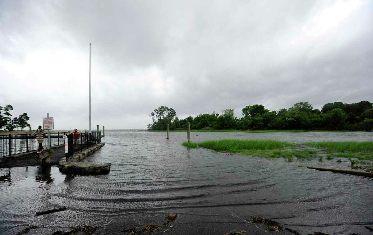 Flooding begins at the Cove Island Marina boat launch as Tropical Storm Isaias passes on August 4, 2020 in Stamford, Connecticut. The first tropical storm of the 2021 season is expected to hit Friday.