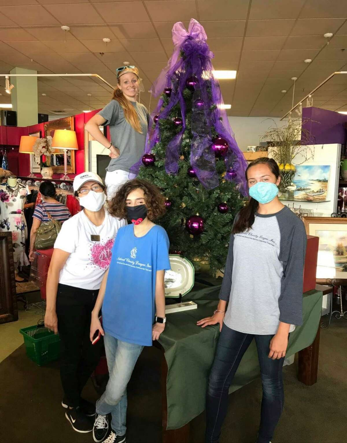 Current NCL Montgomery Monarchs president Annette Smith and several youth members of the organization pose for a photo at Something Special, the re-sale shop that helps provide the Montgomery County Women's Center with direct funding. During the pandemic last year the organization had to find creative ways to continue giving back to the community while still keeping members safe.