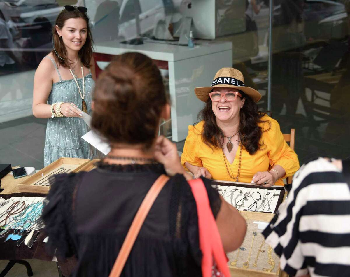 Fahey Fine Jewelry assistant Jane Weiss, left, and founder Susan Fahey chat with a customer at their popup stand.