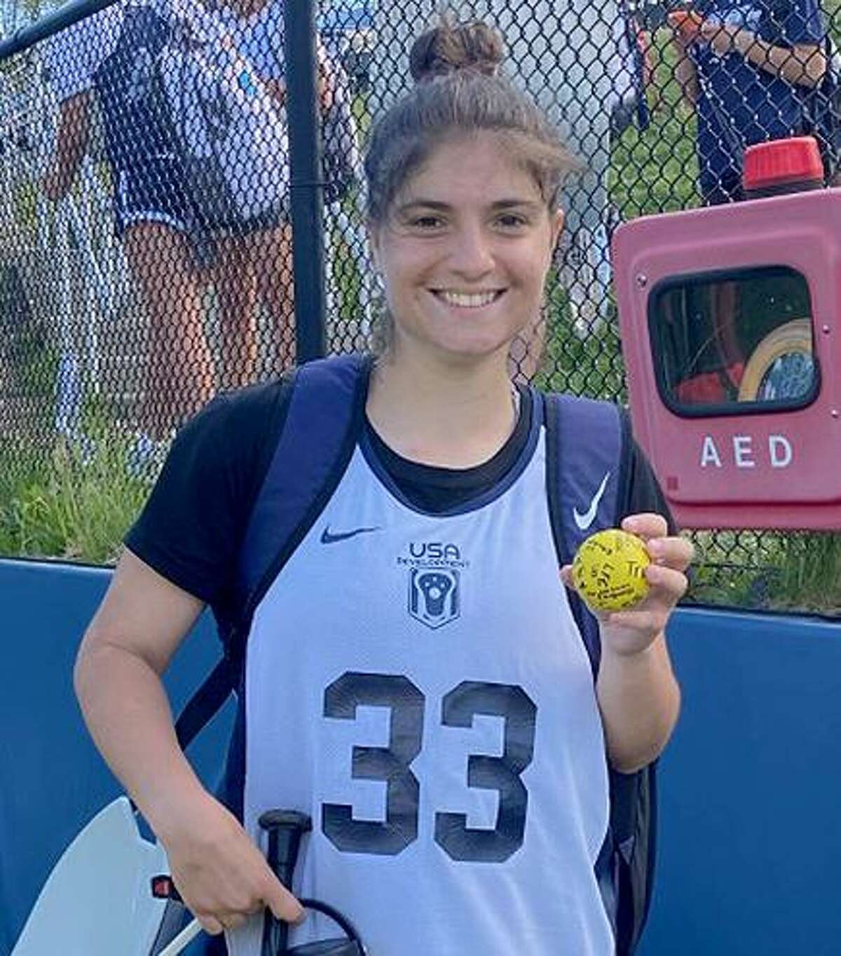 Staples' Shira Parower displays a milestone lacrosse ball marking her 100th career goal after the Wreckers' girls lacrosse team defeated Trumbull 15-7 on Wednesday, May 12, 2021.