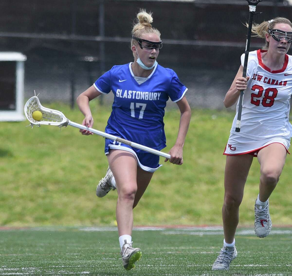 Glastonbury's Sam Forrest (17) races up the field against New Canaan during a girls lacrosse game at Dunning Field on Saturday, May 15, 2021.