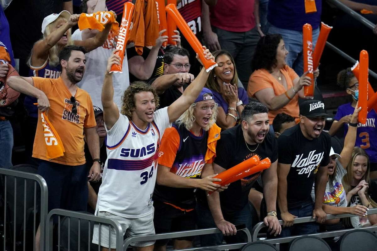 Phoenix Suns fans cheer on their team during the second half of Game 1 of basketball's NBA Finals against the Milwaukee Bucks, Tuesday, July 6, 2021, in Phoenix. The Suns defeated the Bucks 118-105.
