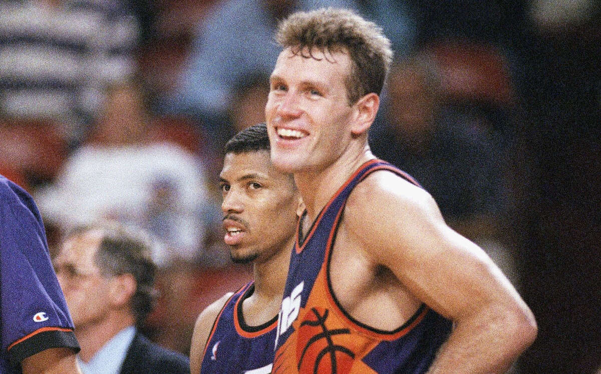 A smiling Dan Majerle of the Phoenix Suns stands next to teammate Kevin Johnson during the closing minutes of the Suns' 108-98 win over the Chicago Bulls in Game 5 of the NBA Finals in Chicago on Friday, June 18, 1993.