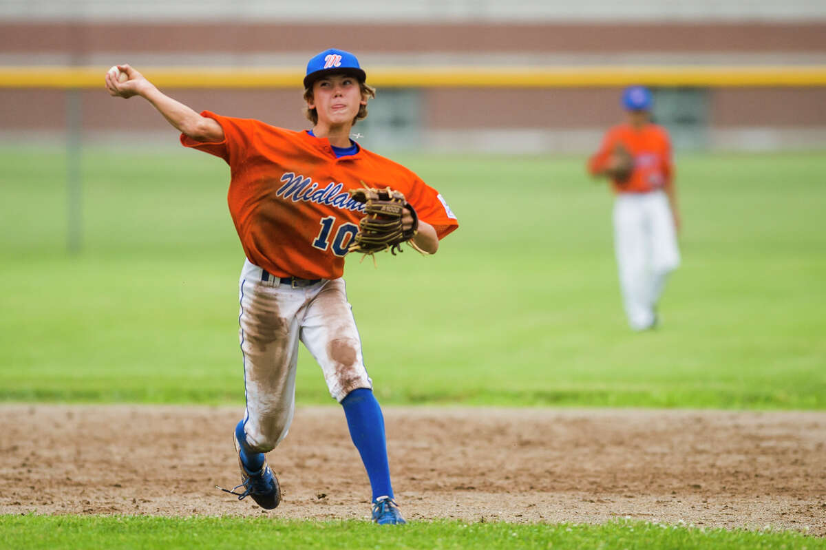 Midland's Eli Kell throws to first base during a Junior League district final against Freeland Thursday, July 8, 2021 at Plymouth Park in Midland. (Katy Kildee/kkildee@mdn.net)