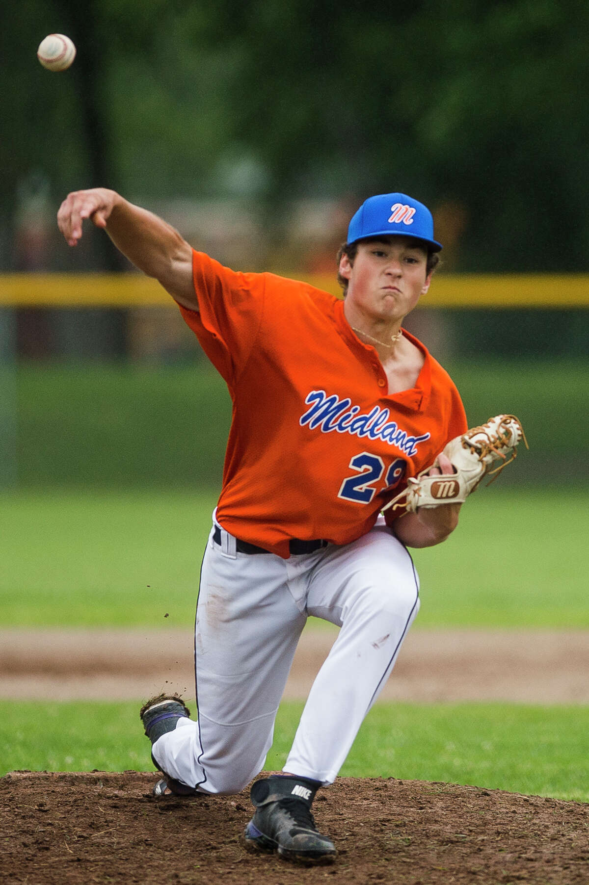 Midland's Ben Vansumeren throws out a pitch during a Junior League district final against Freeland Thursday, July 8, 2021 at Plymouth Park in Midland. (Katy Kildee/kkildee@mdn.net)