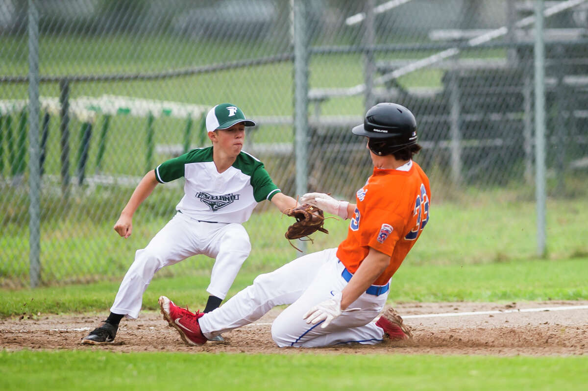 Midland's Greyson Campi slides into third base during a Junior League district final against Freeland Thursday, July 8, 2021 at Plymouth Park in Midland. (Katy Kildee/kkildee@mdn.net)