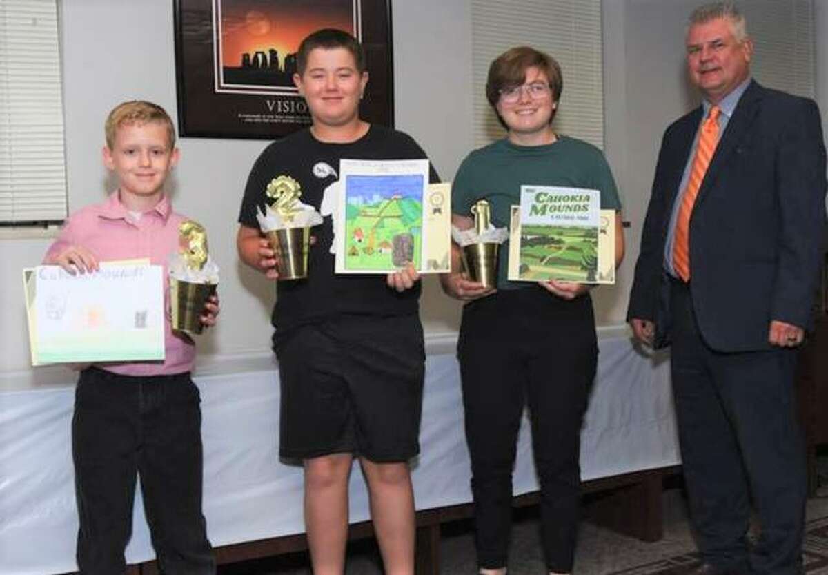 Winners have been named in the Cahokia Mounds National Park Poster Contest sponsored by Madison County Regional Superintendent Robert Werden. From left are Landon Hancock, 4th grade from Alton, third; Luke Schaible, 6th grade from Highland, second; Lily Relleke, 11th grade from Granite City, first; and Werden.