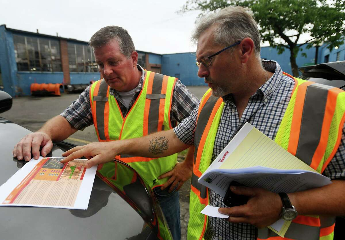 Superintendent of Public Services Tim Nolan, left, and Public Works Director Antonio Indarola look at the latest track of storm Elsa in preparation for the arrival of the storm and potential high winds in Danbury, Conn. on Thursday, July 08, 2021.