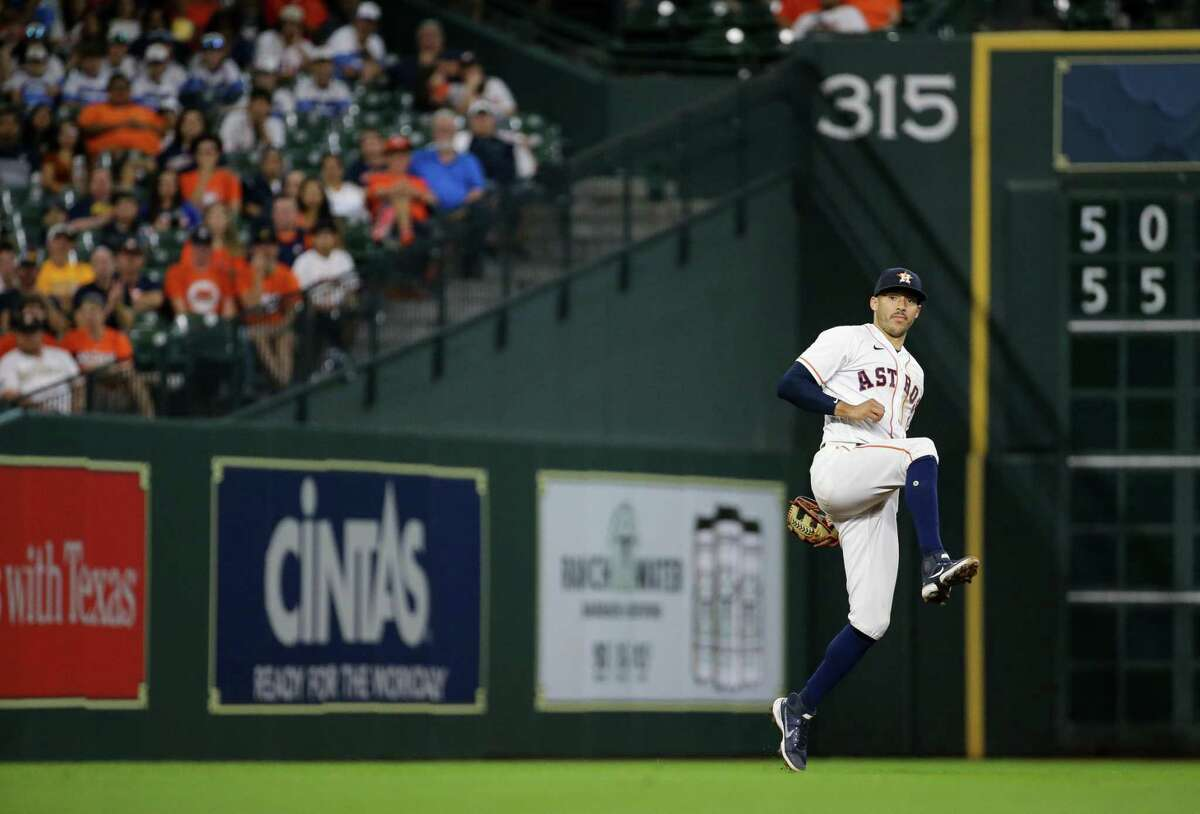 Houston Astros shortstop Carlos Correa (1) throws a ball to first base for an out against the Oakland Athletics during the 9th inning of an MLB game at Minute Maid Park on Thursday, July 8, 2021, in Houston.
