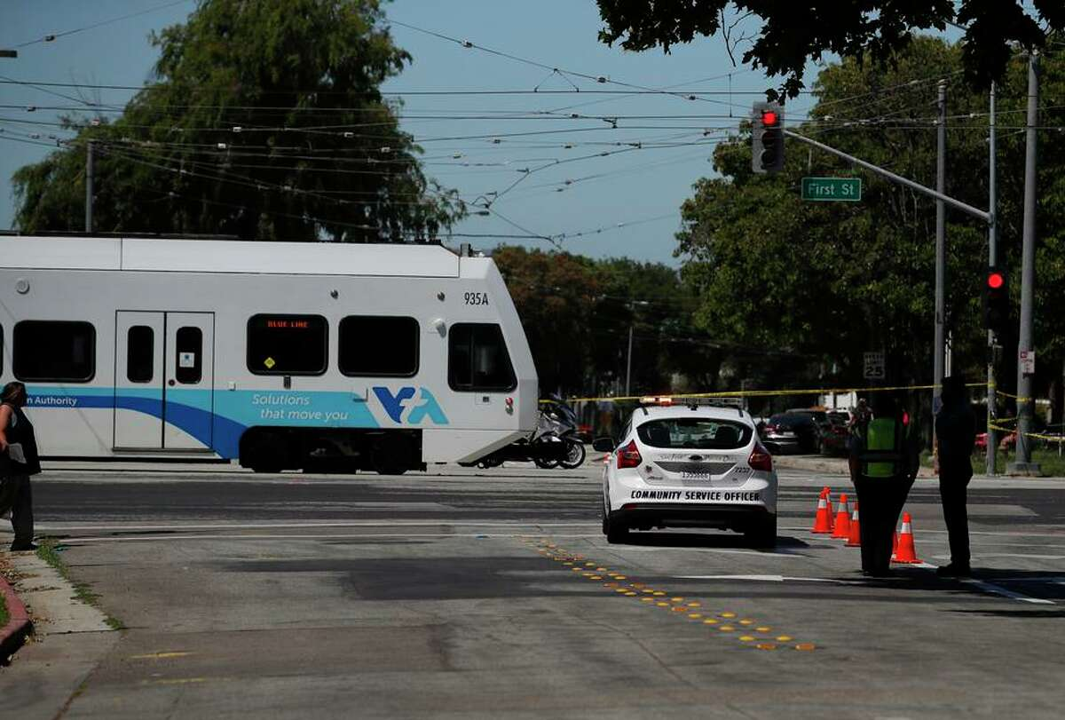 A Blue Line train crosses North First Street and Younger Avenue in San Jose, near where a disgruntled worker killed nine VTA employees and himself on May 26.