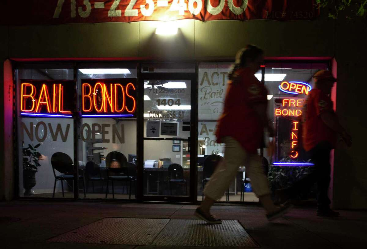 Action Bail Bonds is photographed at night Wednesday, June 30, 2021, in downtown Houston. Defendants usually pay bail bonds companies 10 percent of their surety bond amount to get out of jail.