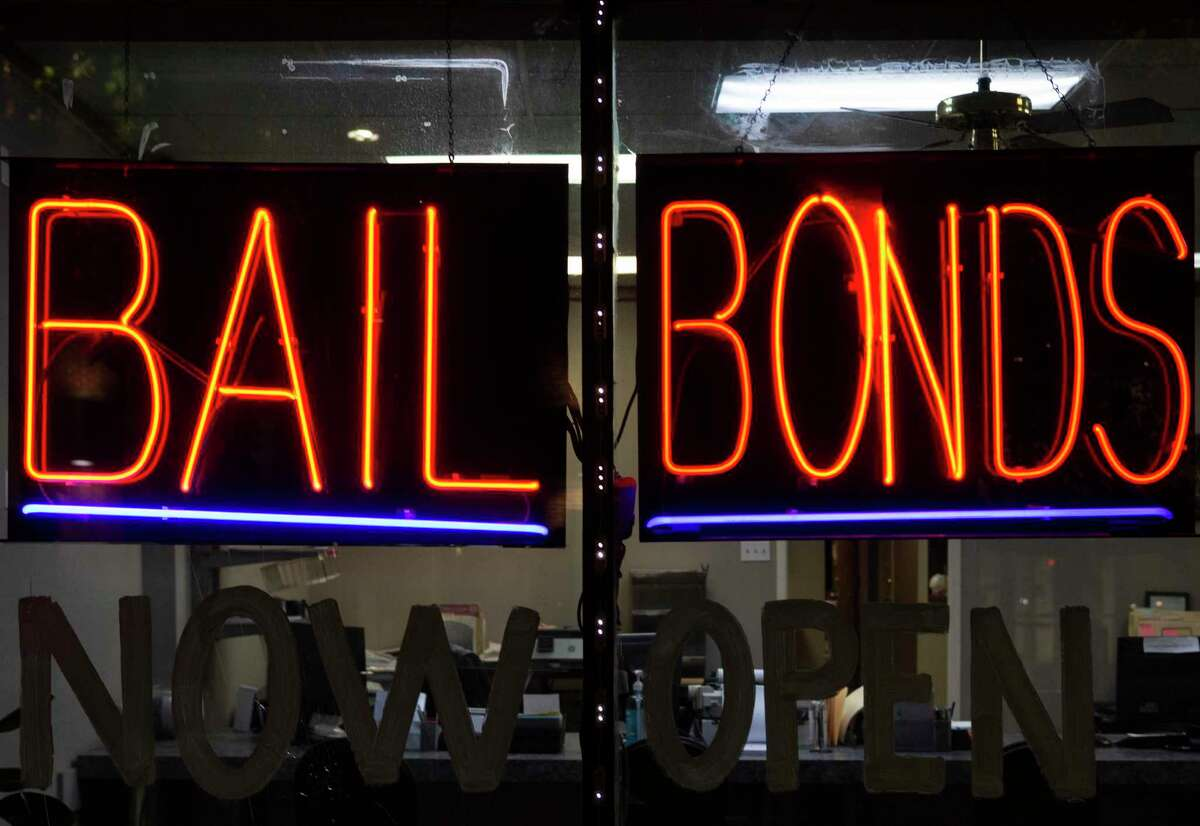 Action Bail Bonds is photographed at night Wednesday, June 30, 2021, in downtown Houston.