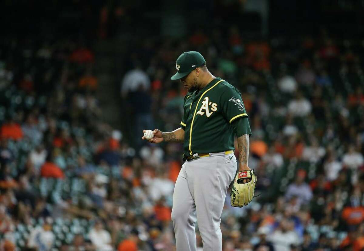 Oakland Athletics starting pitcher Frankie Montas (47) looks at a ball between pitches in the fifth inning of an MLB game against the Houston Astros at Minute Maid Park on Thursday, July 8, 2021, in Houston. Montas had 10 strikeouts through five innings.