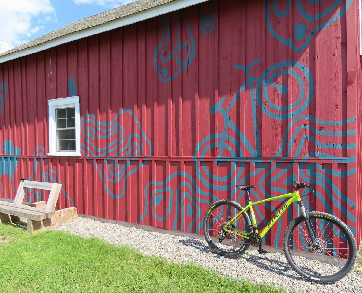 The bike-inspired mural at the Fairgrounds Trail of the Slate Valley Trails.