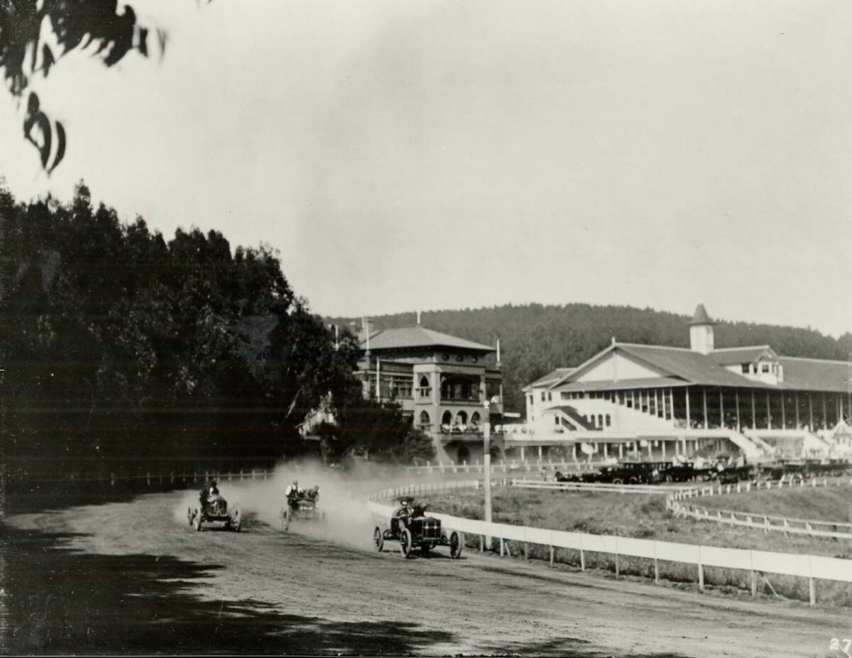 Automobiles race on the Ingleside Racetrack in the early 20th century after horse racing was halted there.