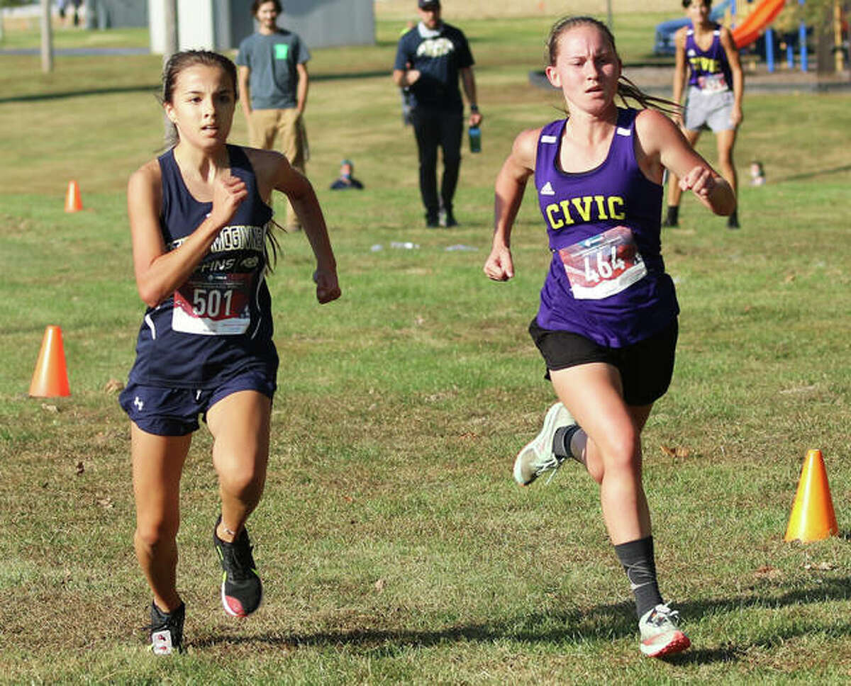 CM's Hannah Meiser, right, and Father McGivney's Kaitlyn Hatley sprint together in the final 40 yards of the Madison County Meet on Oct. at Belk Park in Wood River.