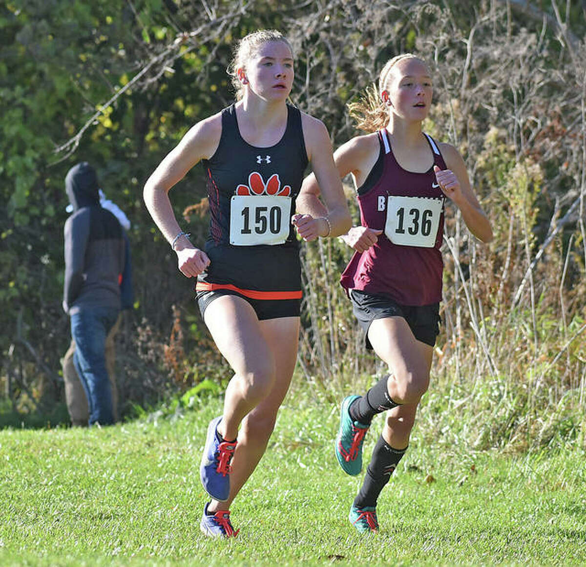 Edwardsville's Riley Knoyle, left, and Belleville West's Alyssa Elliott run side by side at the Class 3A Normal Community Sectional.