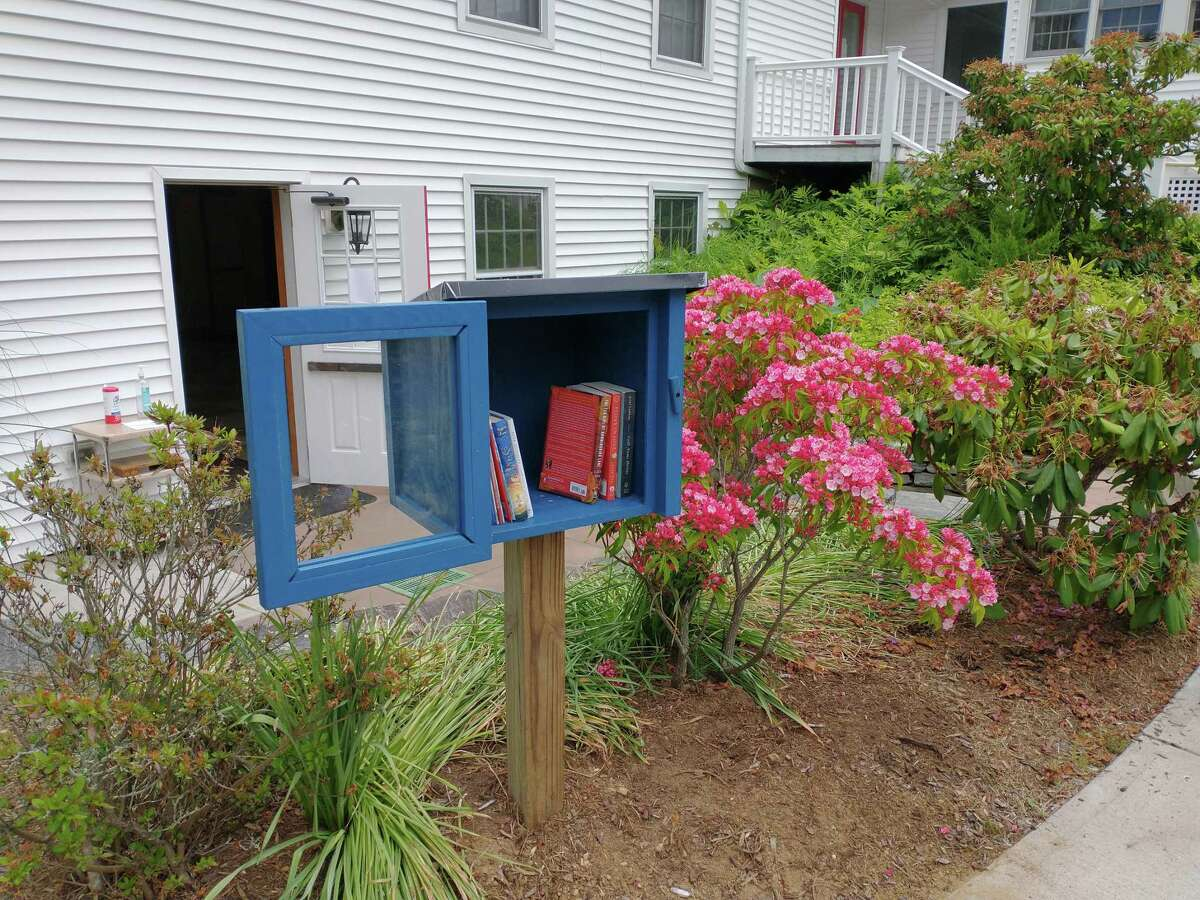 Adjacent to the parking lot at Shoreline Unitarian Universalist Society, 297 Boston Post Road in Madison, visotors can drive up and pick out a free book to read or give a book to share with others. Looking like an oversized bird house, this chartered Little Free Library is part of a network of more than 100,000 registered book-sharing boxes in 108 countries worldwide.