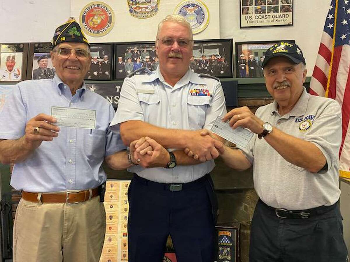 From left, Torrington American Legion Post #38 by Vice Commander Don McLeod presents two $1,250 checks to Civil Air Patrol Capt. Gary Lawton, with Torrington Veteran Service Office Director Mike Thomas.