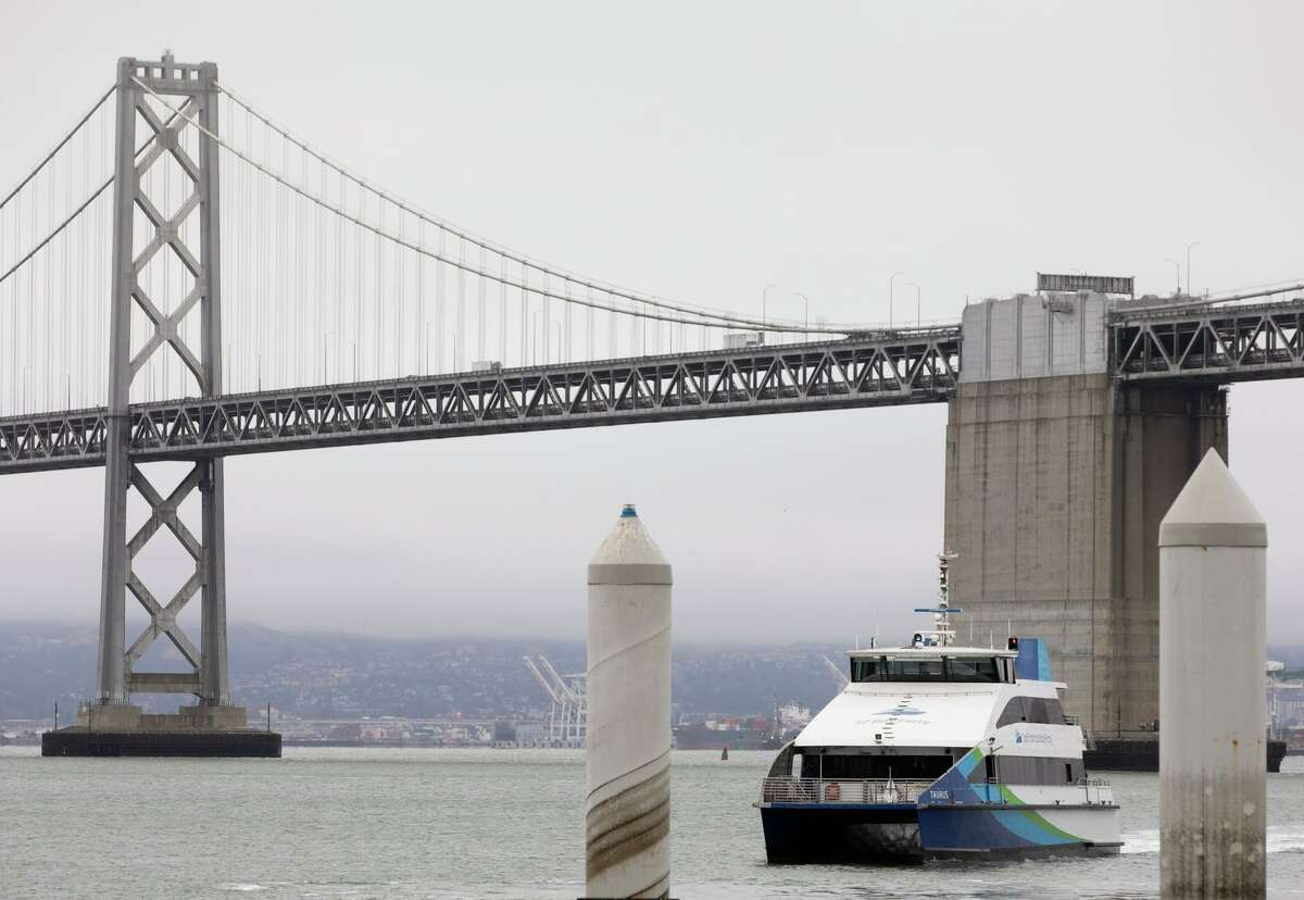 A San Francisco Bay Ferry arrives from Richmond at the ferry terminal in San Francisco, Calif. Tuesday, July 6, 2021. Ferry ridership has slowly increased in recent weeks with more commuters returning to the office and tourists taking public transit.