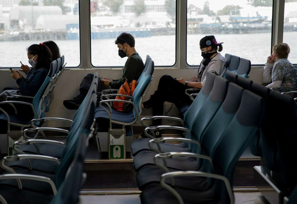 Commuters take a San Francisco-bound boat from Vallejo on Tuesday. Bay Ferry ridership has slowly increased in recent weeks.