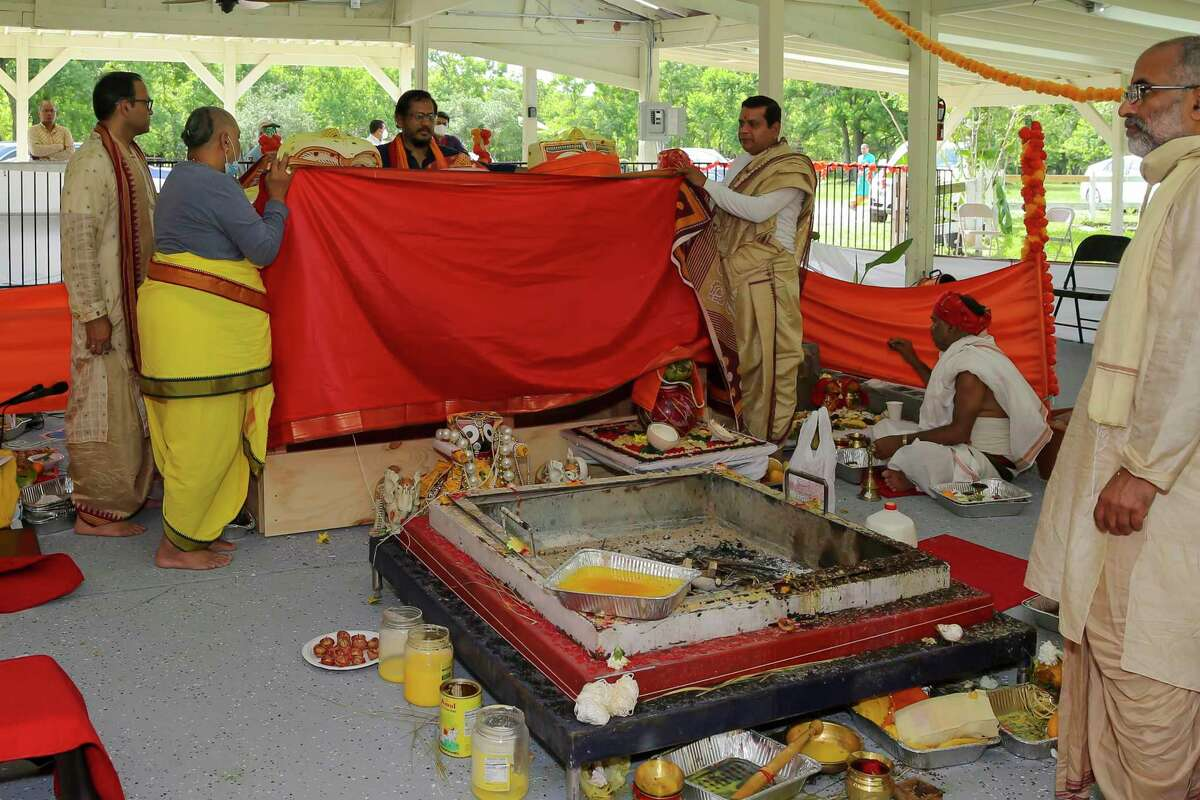 Hindu priests make preparations for the incarnation of deities. This year marks the first time the event will be held at the organization's new home.