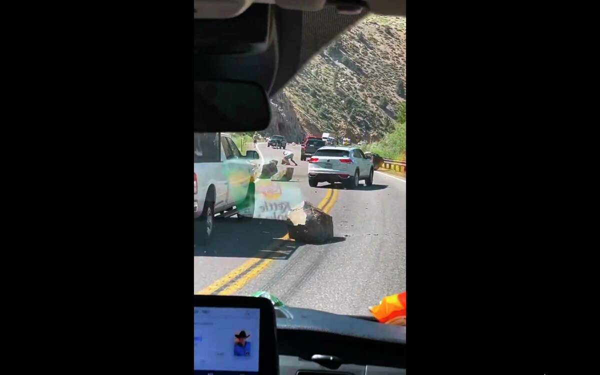 This image from video provided by Brett Durrant shows boulders blocking U.S. Route 395 near the California state line with Nevada, after an earthquake Thursday, July 8, 2021. (Brett Durrant via AP)