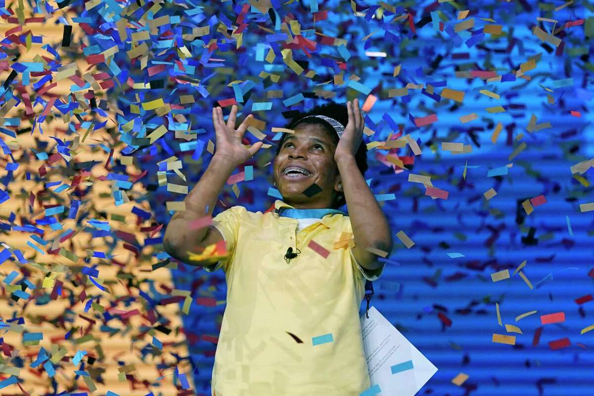 Zaila Avant-garde, 14, from Harvey, Louisiana is covered with confetti as she celebrates winning the finals of the 2021 Scripps National Spelling Bee at Disney World Thursday, July 8, 2021, in Lake Buena Vista, Fla.