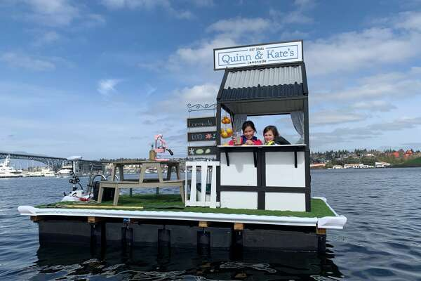 Sisters Quinn and Kate run a lemonade stand from the waters of Lake Union.