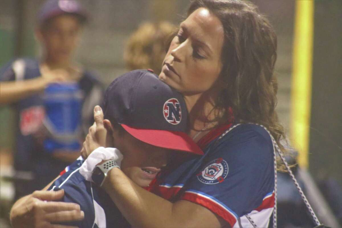 NASA major all-star Carter Grillo is comforted by his mother after he and his teammates saw their season come to an end on a rainy night in Pearland Thursday.