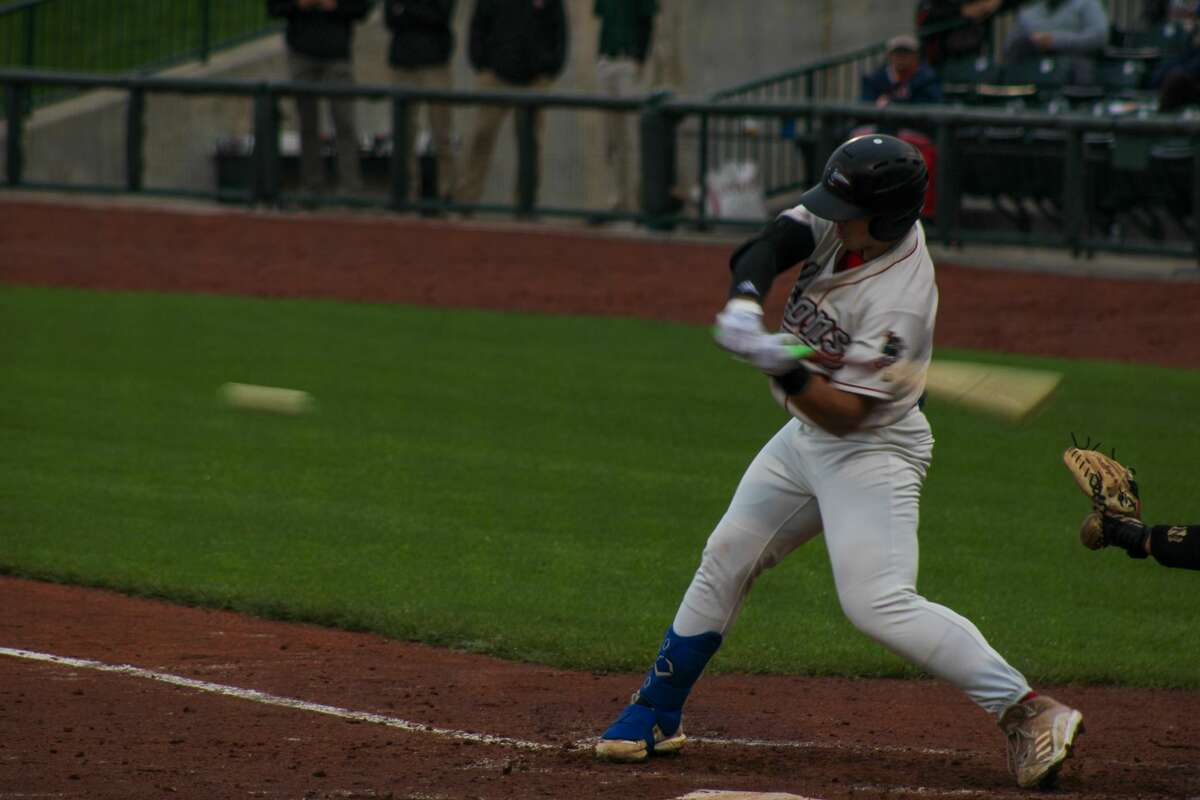 Loons designated hitter Carson Taylor swings at a pitch against Lansing on July 8 at Dow Diamond