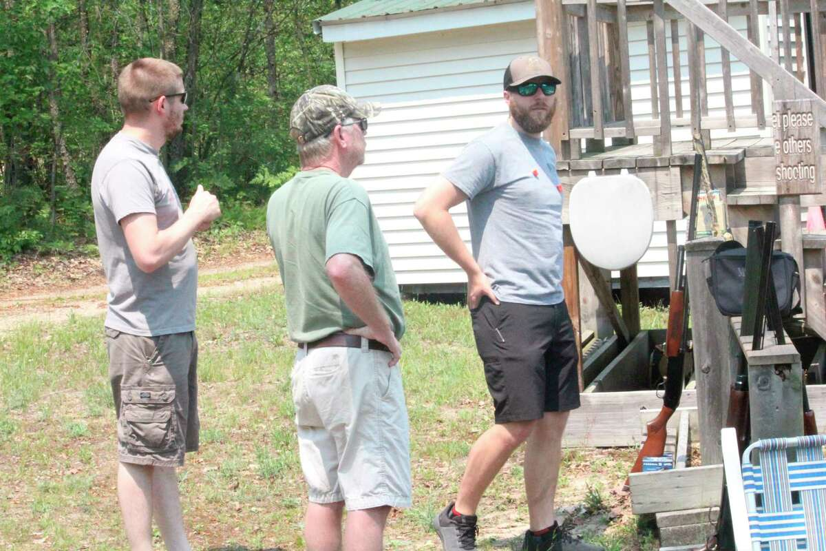 Shooters gather at the Mecosta County Rod & Gun Club on Saturday for the weekly sporting clays shoot. (Pioneer photo/John Raffel)