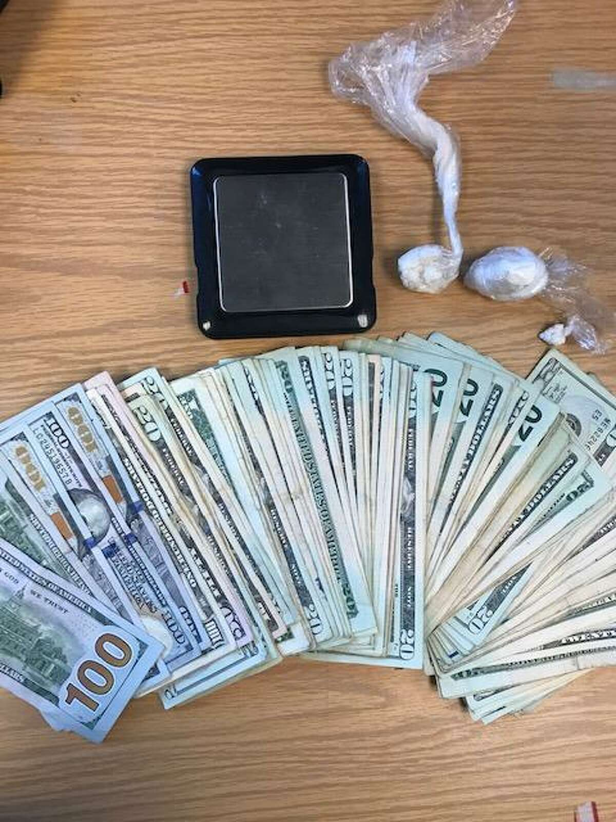 During a search of a New London, Conn., home on Tuesday, July 6, 2021, law enforcement officers seized two loaded handguns, crack cocaine, powder cocaine and $3,252, police said.