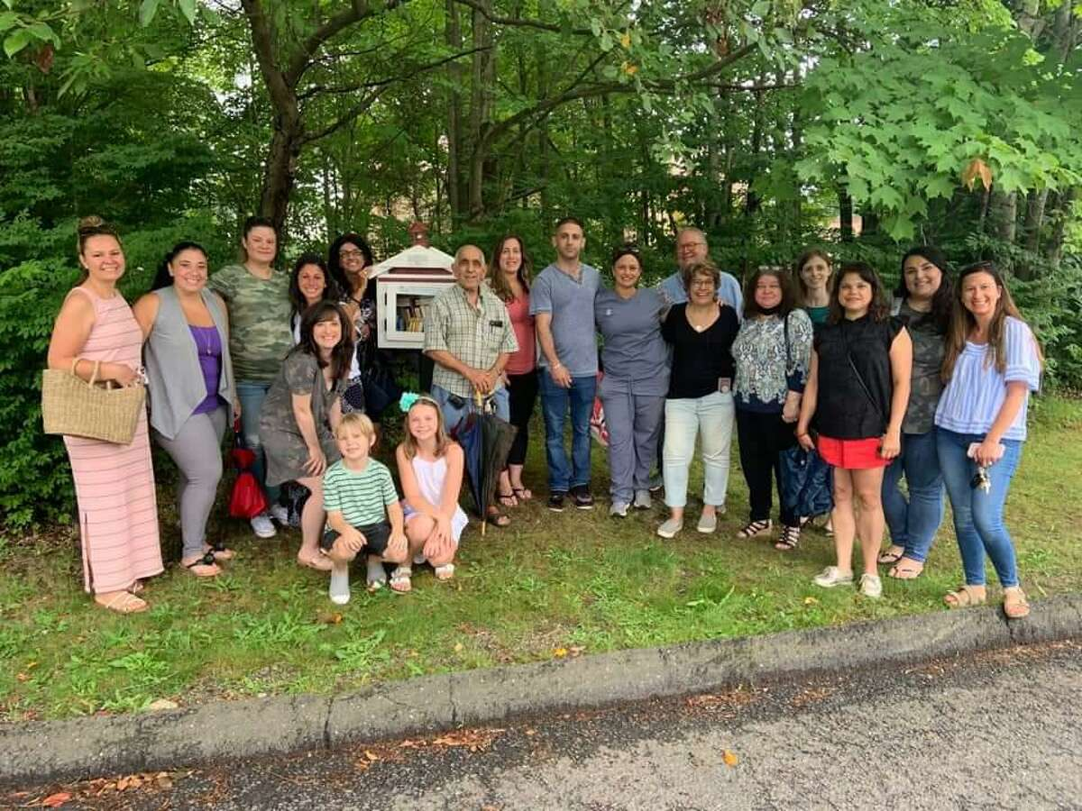 Friends and family of Daniela Forte, who died of ovarian cancer in 2020, gather to celebrate the installation of a Little Free Library in Forte's memory on Friday, July 2.