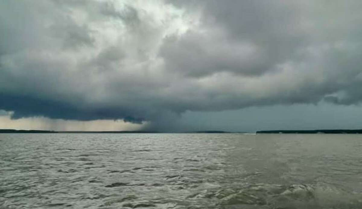 Clouds before a storm can be seen July 4, 2021 above Lake Conroe. With a seemingly never-ending summer rain and peak hurricane season approaching, officials are signaling to ways to keep safe while boating on Lake Conroe.