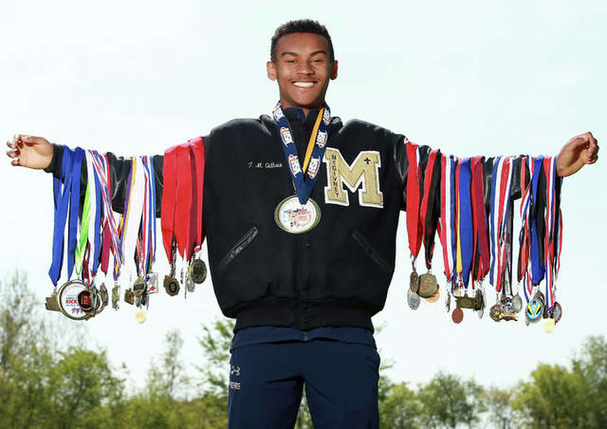 Father McGivney's Tyler Guthrie poses with his medals for his 2019 Telegraph runner of the year award. Guthrie repeats in 2020.