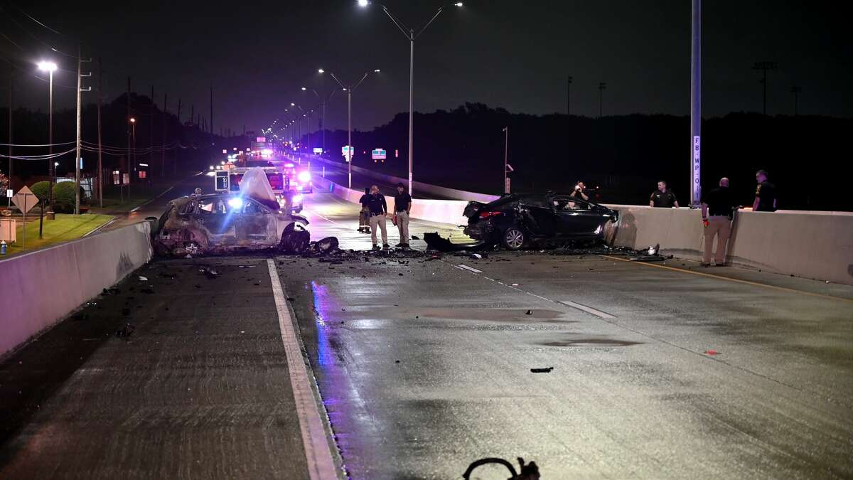Investigators on the scene of a triple-fatal crash early Friday, July 9, on the Westpark Tollway in Mission Bend. A child was among those killed.