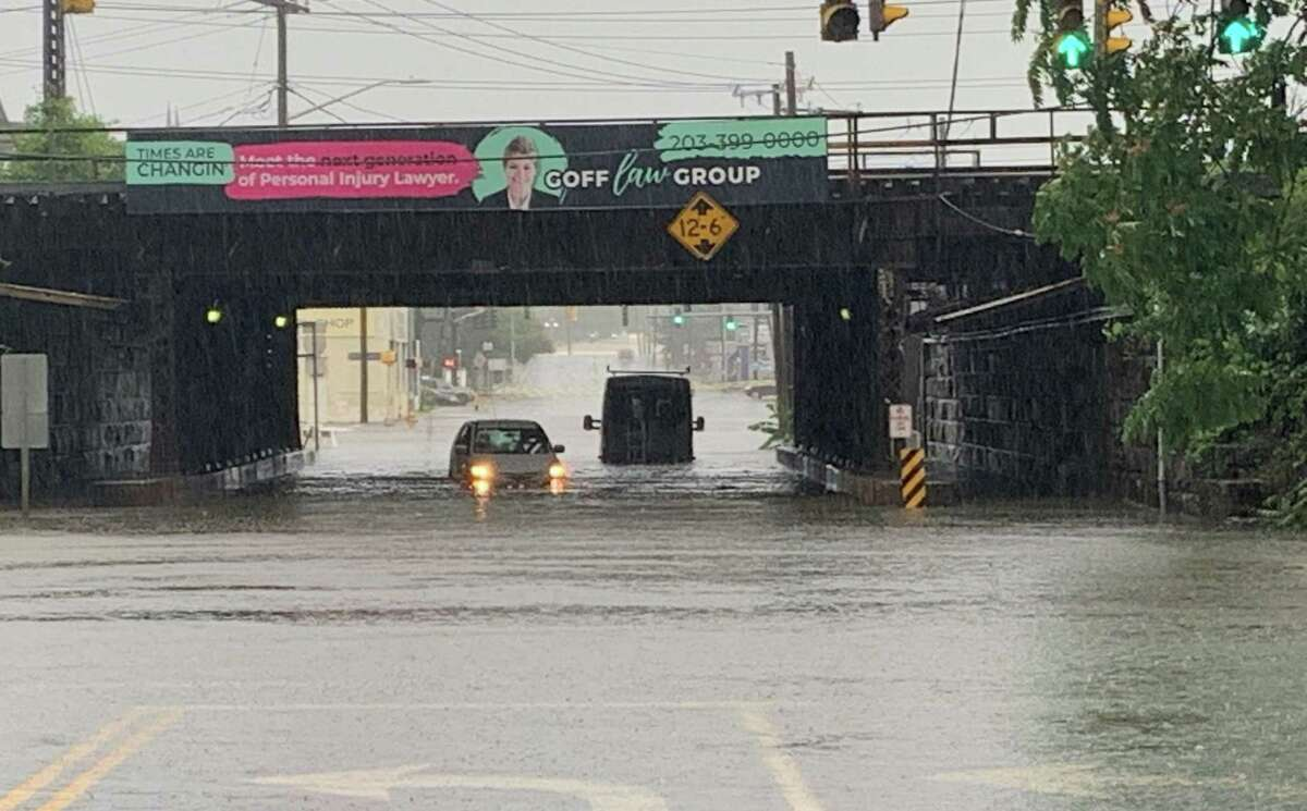 """Sgt. Jeffrey Booth said """"everything is shut down"""" in the area of Elm and South State streets due to extreme flooding near the Interstate 95 on-ramp."""