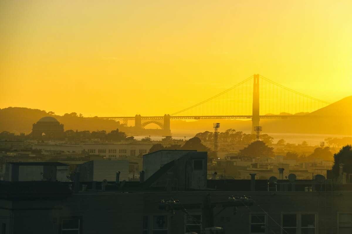 San Francisco urban skyline with Golden Gate Bridge and Palace of Fine Arts at dusk,