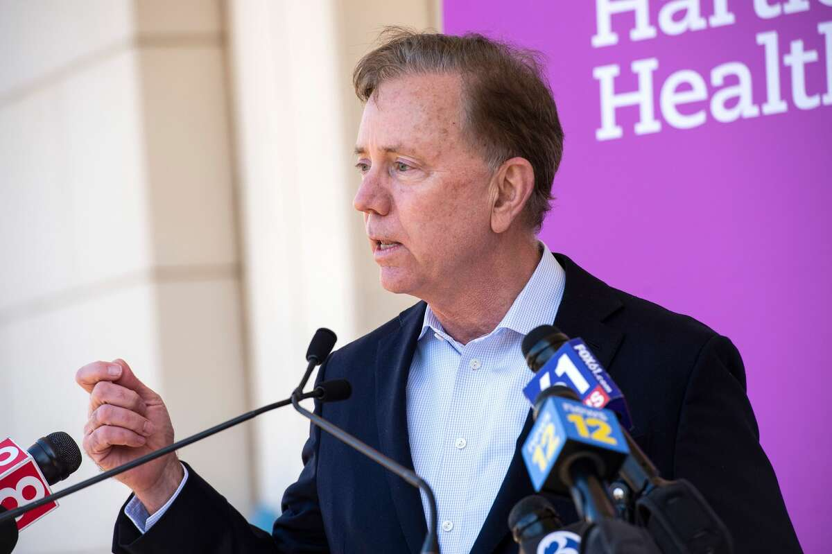 Connecticut Governor Ned Lamont speaks about the states efforts to get more people vaccinated at Hartford HealthCare St. Vincent's Medical Center in Bridgeport, Connecticut on February 26, 2021. - Nine local clergy members were given the Pfizer-BioNTech Covid-19 Vaccine, aiming to educate and inspire their parishioners and minority communities to get vaccinated.
