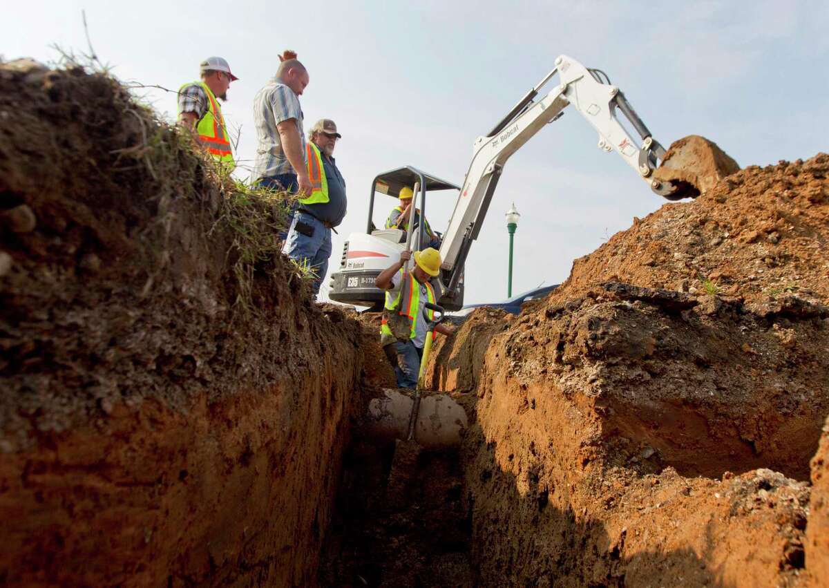 The city of Conroe plans the use of about $15 million from the Coronavirus State and Local Fiscal Recovery Fund grant as part of the American Rescue Plan for several water and sewer rehabilitation projects. In this file photo, crews work on a water line in downtown Conroe.