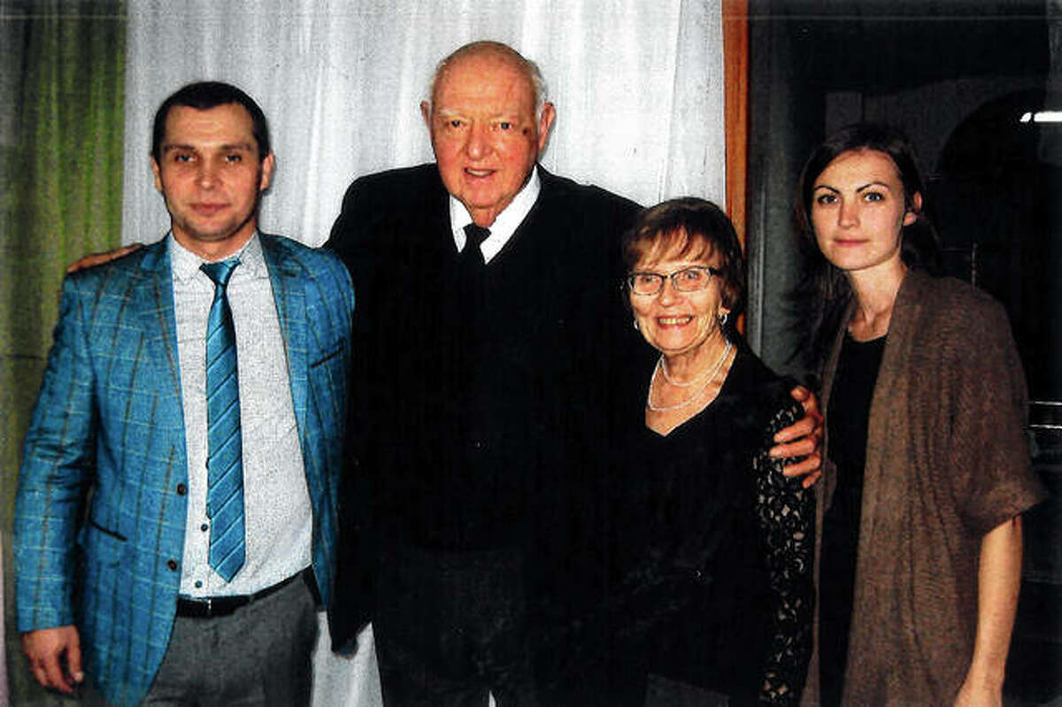 Pete Hughes, second from left, and his wife, Carol, meet Andrew, left, a Russian man who battled against drug addiction, at Vibitie Rehab Center in Novgorod, Russia. The center is housed in a building bought by the Hugheses as part of their commitment to a ministry in Novgorod. Andrew's wife, Elvira, is at right.