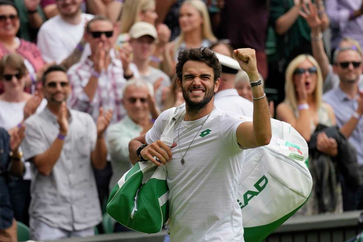 Italy's Matteo Berrettini celebrates after defeating Poland's Hubert Hurkacz during the men's singles semifinals match on day eleven of the Wimbledon Tennis Championships in London, Friday, July 9, 2021.