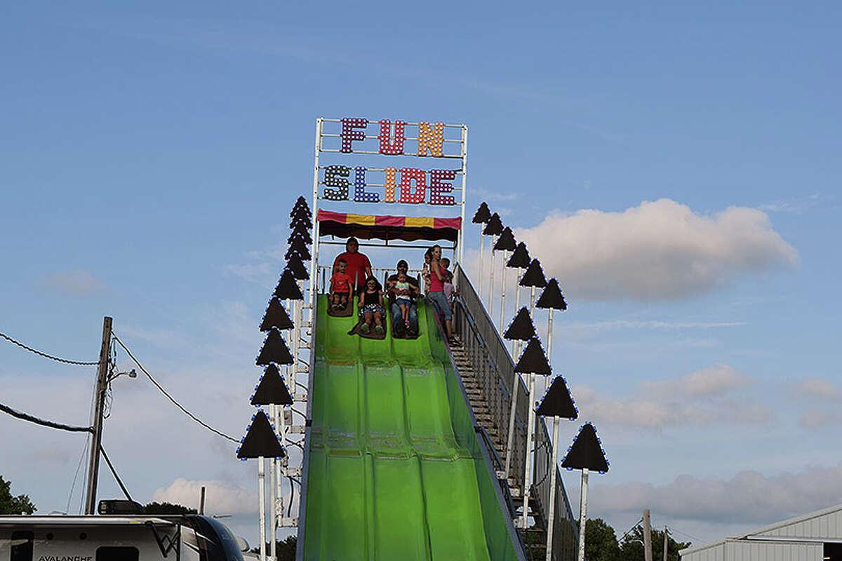 A group gets ready to take a trip down a giant fun slide at the Morgan County Fair.
