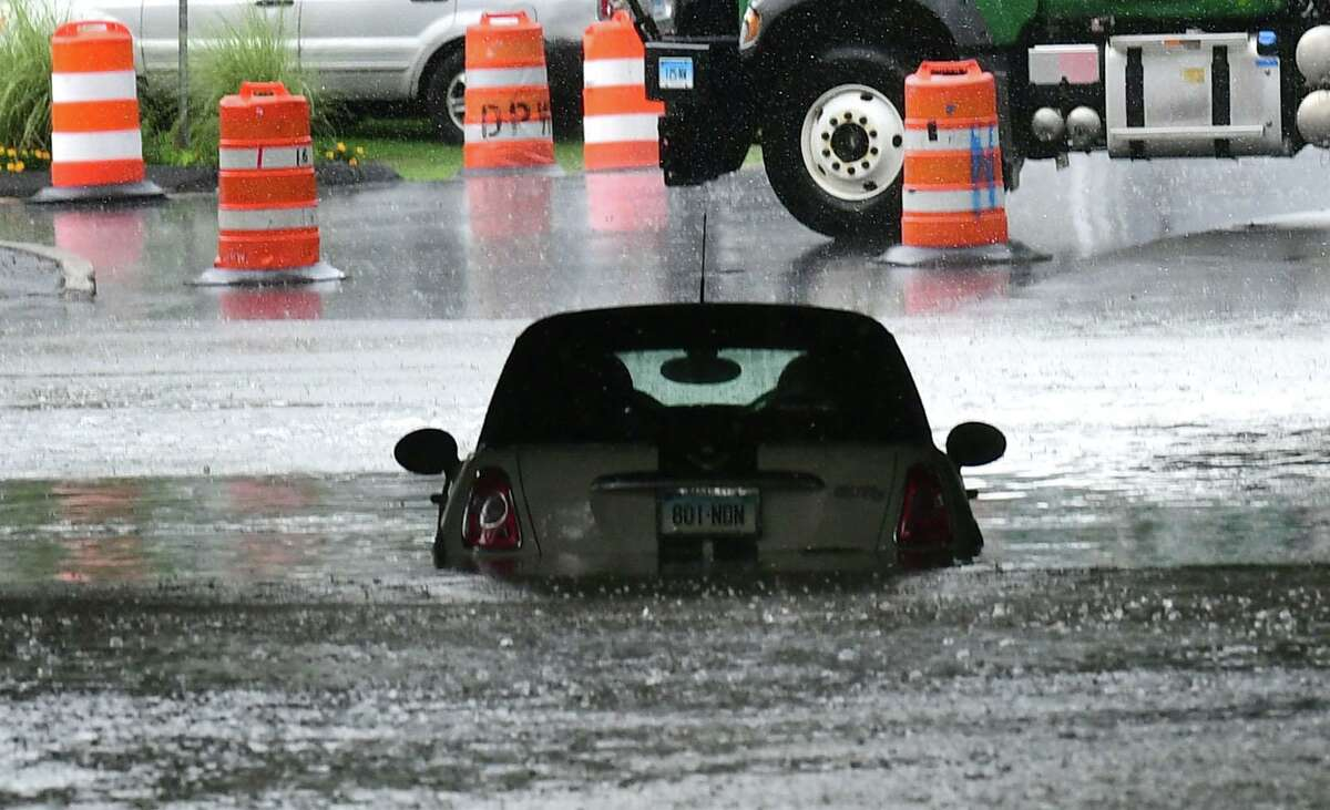 Flooding on Strawberryhill Ave during the storm Friday, July 9, 2021, in Norwalk, Conn.
