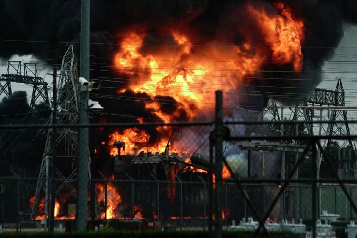 A fire burns at a Centerpoint substation just west of Brittmore Road at Kempwood Drive on Friday, July 9, 2021.