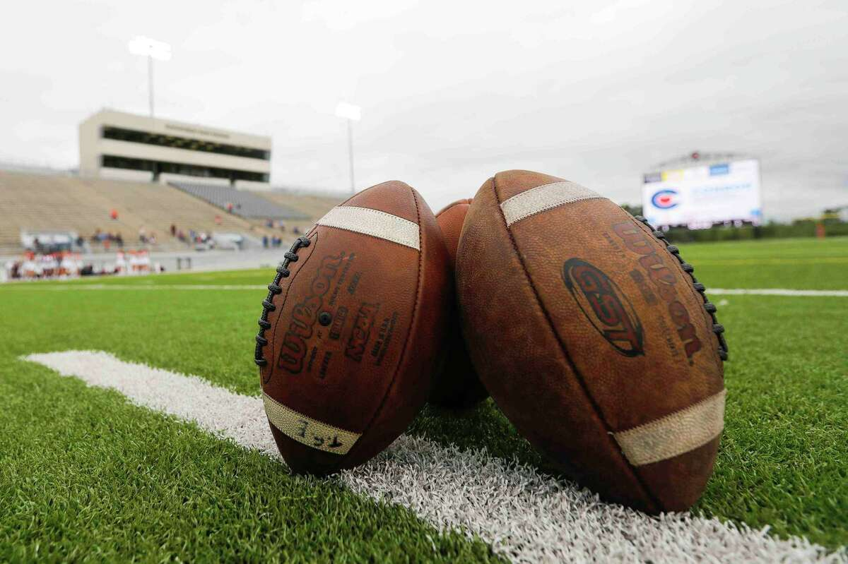 Footballs are seen before a non-district high school football game at Woodforest Bank Stadium, Thursday, Sept. 24, 2020, in Shenandoah.