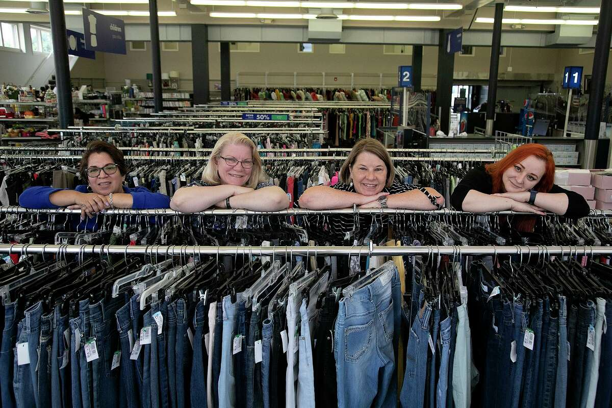 Maria Z. Aguillon, from left, shown with fellow Goodwill workers Trina Hibbard, Janet Ward and Lauren Serrato, was perplexed about the siren's source.